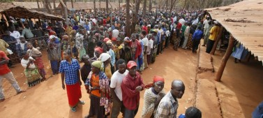 People lining up for mosquito nets in Nyarugusu Camp.